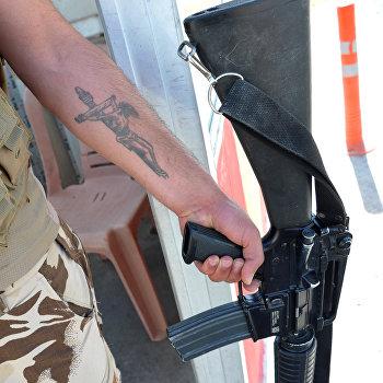 Бойцы курдских отрядов, воюющие против ИГ