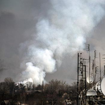 Последствия пожара на складе боеприпасов в Харьковской области