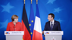 РИА Новости: Трамп отказал Макрону и Меркель. США и ЕС в ожидании торговой войны