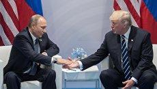 RT: Два часа на высшем уровне: как прошла первая встреча Путина и Трампа